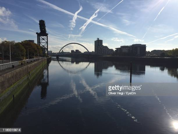 bridge over river by buildings against sky - govan stock pictures, royalty-free photos & images