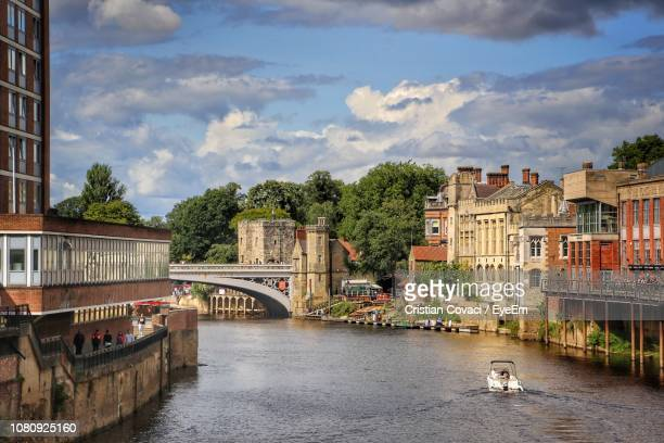 bridge over river by buildings in city against sky - york yorkshire stock pictures, royalty-free photos & images