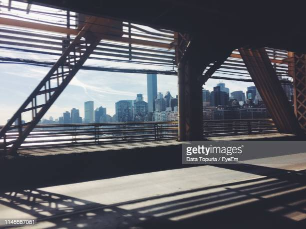 bridge over river by buildings in city against sky - data topuria stock pictures, royalty-free photos & images