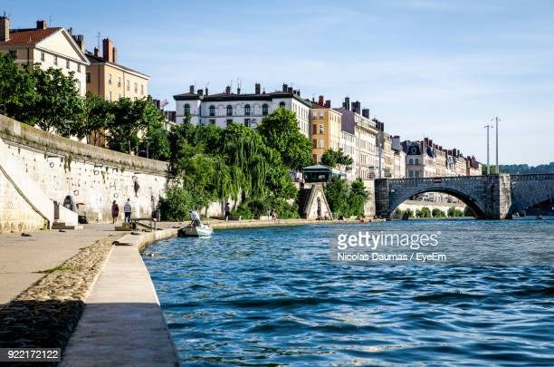 bridge over river by buildings in city - rhone stock pictures, royalty-free photos & images