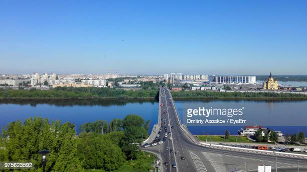 bridge over river by city against clear sky - nizhny novgorod oblast stock photos and pictures