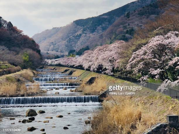 bridge over river by mountains against sky - kanagawa prefecture stock pictures, royalty-free photos & images
