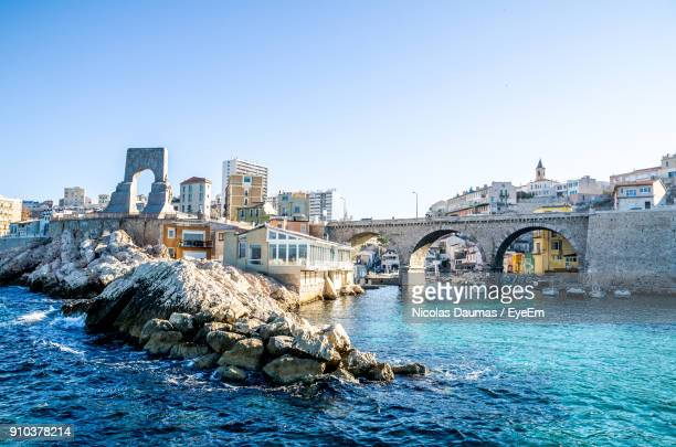 bridge over river in city against clear blue sky - marseille photos et images de collection