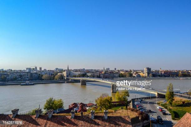 bridge over river in city against clear sky - fedor stock pictures, royalty-free photos & images