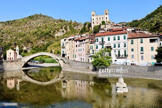 bridge over river in city against clear sky - san remo italy stock pictures, royalty-free photos & images