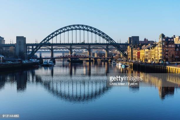 bridge over river in city against clear sky - newcastle upon tyne stockfoto's en -beelden