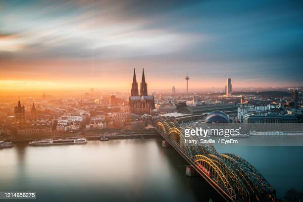 bridge over river in city against sky - cologne stock pictures, royalty-free photos & images