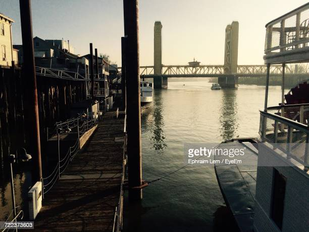 bridge over river in city against sky - ephraim lem stock pictures, royalty-free photos & images