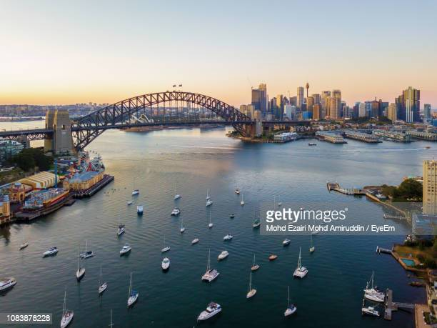 bridge over river in city - sydney stock pictures, royalty-free photos & images