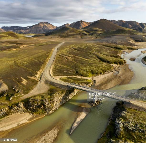 bridge over river near hills - drainage_basin stock pictures, royalty-free photos & images