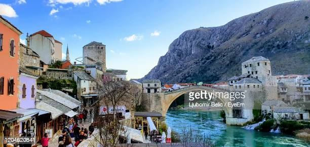 bridge over river with buildings in background - ljubomir belic stock pictures, royalty-free photos & images