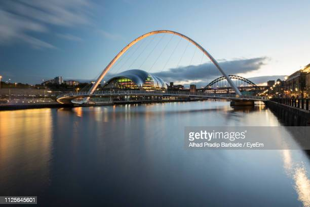 bridge over river with city in background - newcastle upon tyne stock pictures, royalty-free photos & images