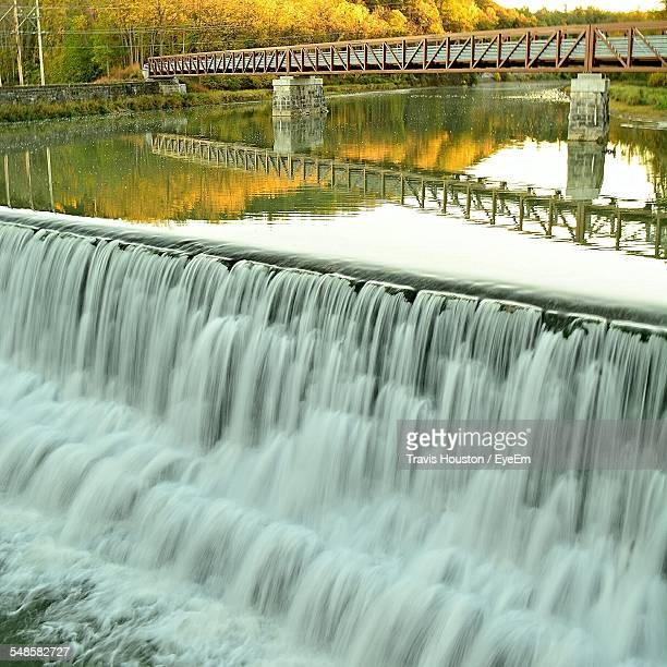 bridge over river with waterfall - state college pennsylvania stock photos and pictures