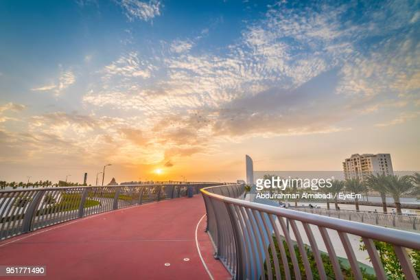 bridge over road against sky during sunset - jiddah stock pictures, royalty-free photos & images