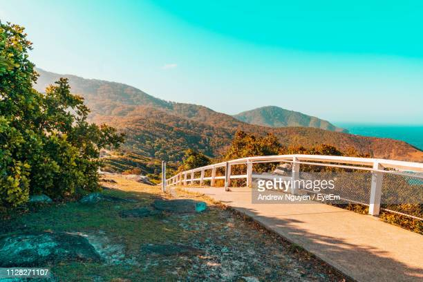 bridge over road against sky - port macquarie stock pictures, royalty-free photos & images