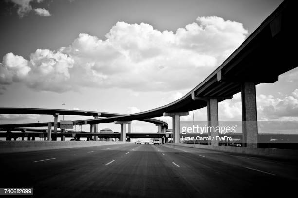 bridge over road in city against sky - flyover stock pictures, royalty-free photos & images