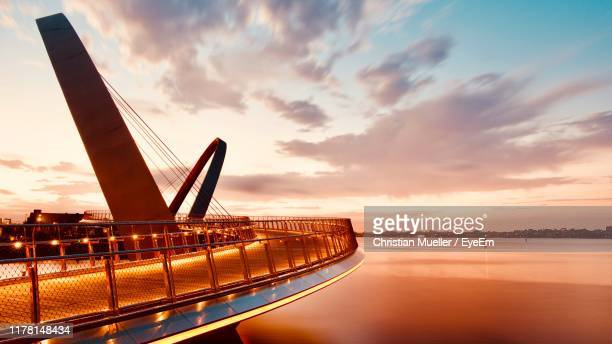 bridge over sea against sky during sunset - perth stock pictures, royalty-free photos & images