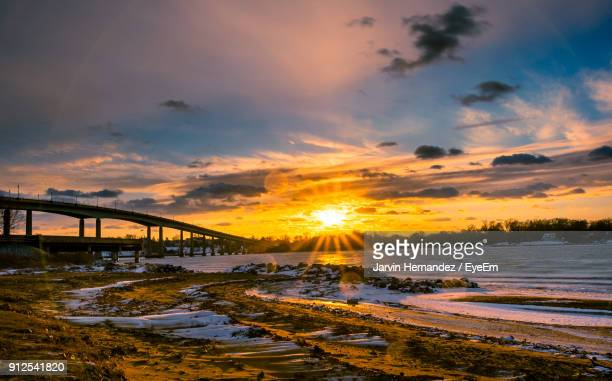 bridge over sea against sky during sunset - annapolis stock pictures, royalty-free photos & images