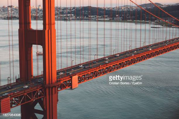 bridge over sea against sky in sunset - bortes stock pictures, royalty-free photos & images