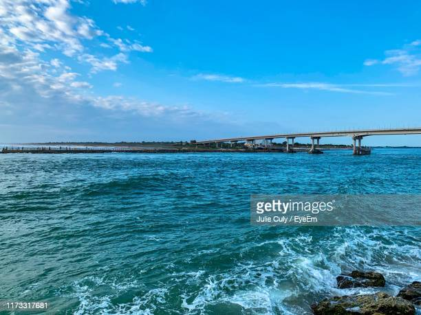 bridge over sea against sky - julie culy stock pictures, royalty-free photos & images