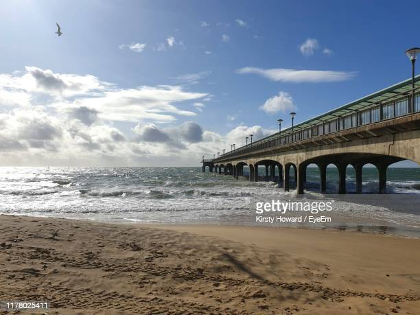 bridge over sea against sky - bournemouth stock pictures, royalty-free photos & images
