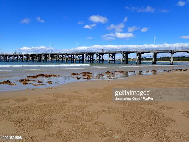 bridge over sea against sky - coffs harbour stock pictures, royalty-free photos & images