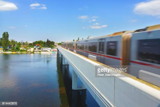 Bridge over the Danube river with a subway train in Vienna, Austria
