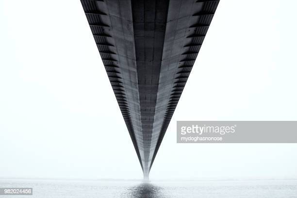 a bridge over the humber estuary in the united kingdom - vanishing point stock pictures, royalty-free photos & images