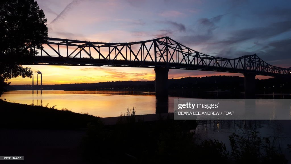 Bridge over the river at sunset : Stock Photo