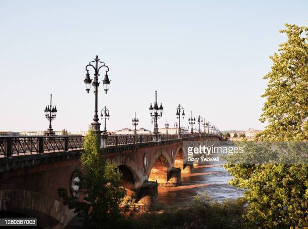 bridge over the river garonne bordeaux - ボルドー ストックフォトと画像