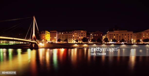 bridge over the river rhone in lyon at night - auvergne rhône alpes stock photos and pictures