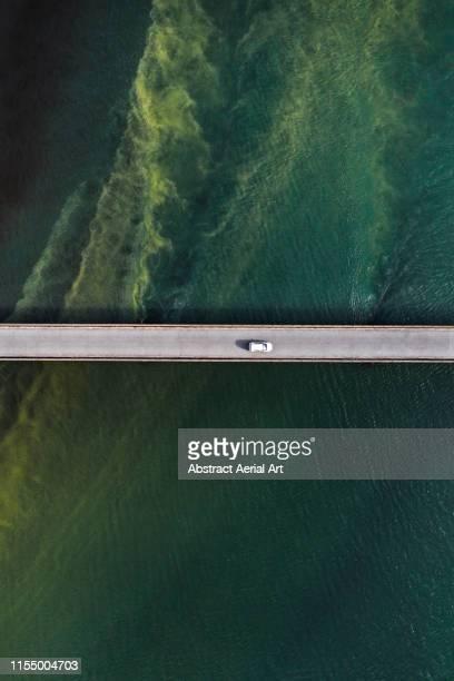 Bridge over unusual water patterns, Iceland