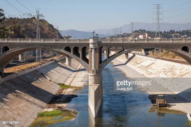 bridge over urban aqueduct of los angeles river, los angeles, california, united states - drought stock pictures, royalty-free photos & images