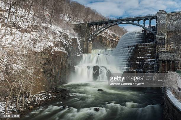 bridge over waterfall on new croton dam - westchester county stock photos and pictures