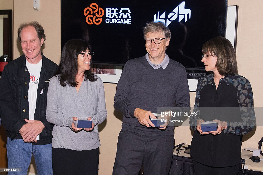 Bridge Players Fred Gitelman, Sheri Winestock, Bill Gates and Sharon Osberg pose for a photo before playing the first live Yeh Online Bridge World Cup at Silver Cloud Hotel on October 31, 2016 in Seattle, Washington.