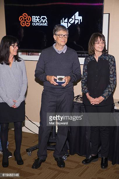 Bridge Players Sheri Winestock Bill Gates and Sharon Osberg pose for a photo before playing the first live Yeh Online Bridge World Cup at Silver...