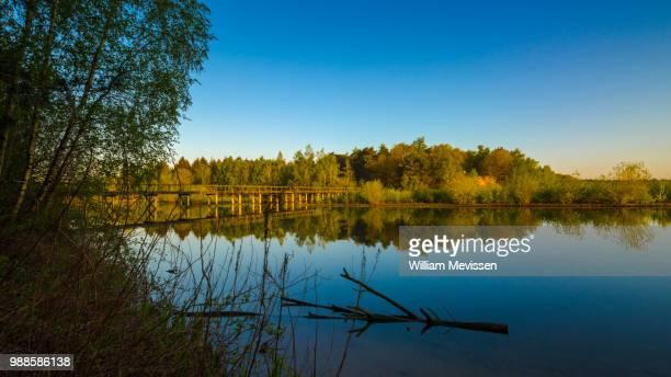 bridge reflections - william mevissen fotografías e imágenes de stock