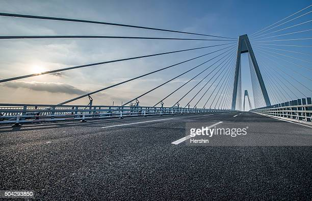bridge road in motion - man made structure stock pictures, royalty-free photos & images