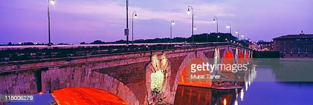 Bridge spanning a river at dusk