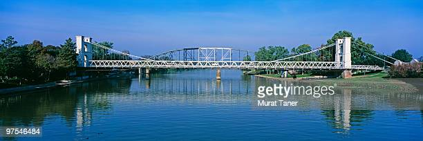 bridge spanning a river - waco stock pictures, royalty-free photos & images