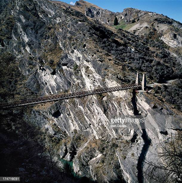 A bridge spans Skippers Canyon a scenic area of gorges peaks and sheer rock faces situated close to Queenstown on New Zealand's South Island The...