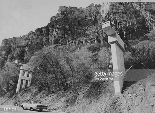 DEC 6 1977 Bridge Structures Are Just Test A car driving through scenic Glenwood Canyon passes two large plywood bridge structures designed to give...