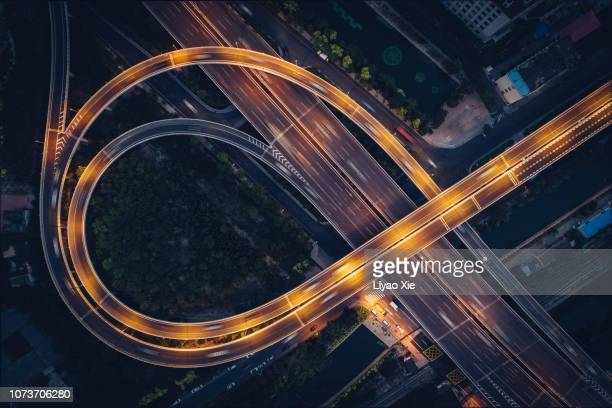 bridge traffic at night - liyao xie stock pictures, royalty-free photos & images