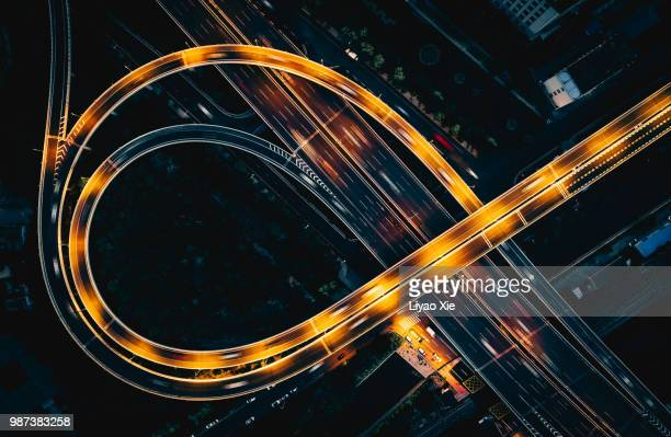 bridge traffic at night - aerial view stock pictures, royalty-free photos & images