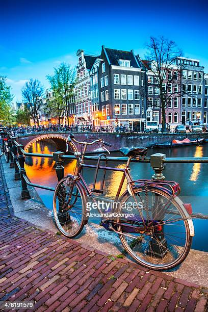 Bridge with Bicycle and Water Channel in Amsterdam at Night