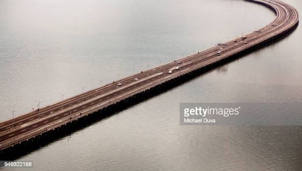 Bridge with cars over bay of water