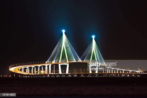 bridge with lighting on the pier - songdo ibd stock pictures, royalty-free photos & images
