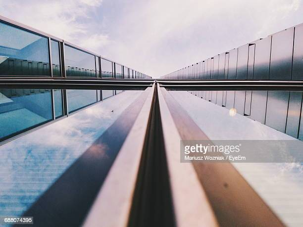 Bridge With Reflection Over River Against Sky