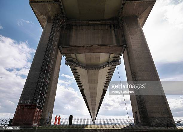 bridge workers inspecting suspension bridge. the humber bridge, uk was built in 1981 and at the time was the worlds largest single-span suspension bridge - monty rakusen stock pictures, royalty-free photos & images