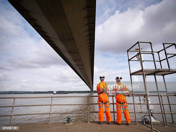 bridge workers under suspension bridge. the humber bridge, uk was built in 1981 and at the time was the worlds largest single-span suspension bridge - monty rakusen stock pictures, royalty-free photos & images